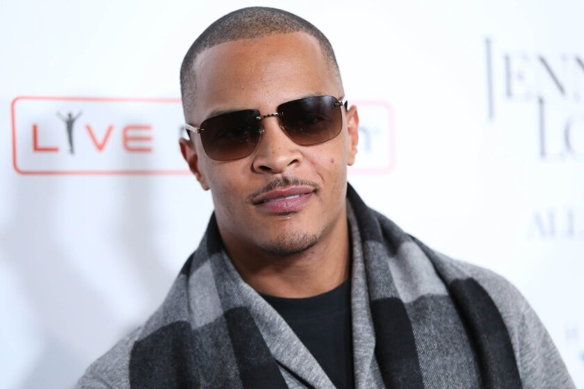"""FILE- In this Jan. 20, 2016, file photo, T.I. arrives at the grand opening of """"Jennifer Lopez: All I Have"""" show at Planet Hollywood Resort & Casino in Las Vegas. According to authorities several people were shot at a T.I concert in New York, Wednesday, May 25, 2016. (Photo by Omar Vega/Invision/AP,"""