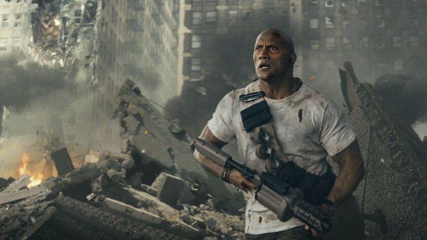 "DWAYNE JOHNSON as Davis Okoye in New Line Cinema's action adventure ""RAMPAGE,"" a Warner Bros. Pictur"