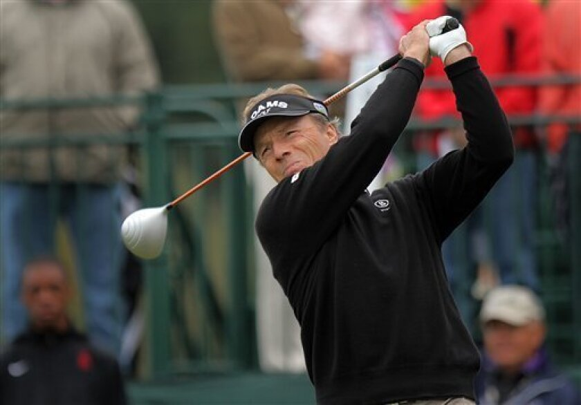 Bernhard Langer watches his drive from the first tee during the final round of the SAS PGA Champions Tour golf tournament at Prestonwood Country Club in Cary, N.C., Sunday, Oct. 7, 2012. Langer was 7-under after playing 14 holes, taking the lead from Fred Funk. (AP Photo/Ted Richardson)
