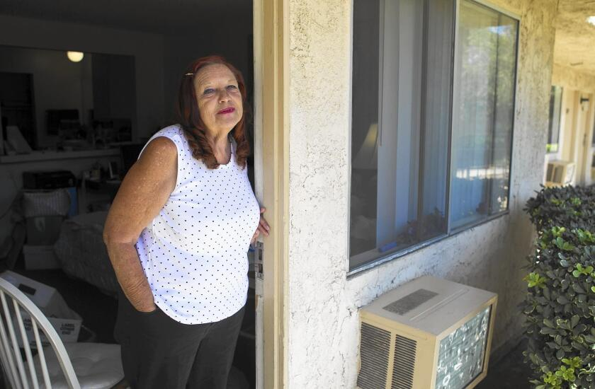 Karen Sullivan and her husband have lived at the Costa Mesa Motor Inn for 18 months. They're preparing to move to an apartment nearby.