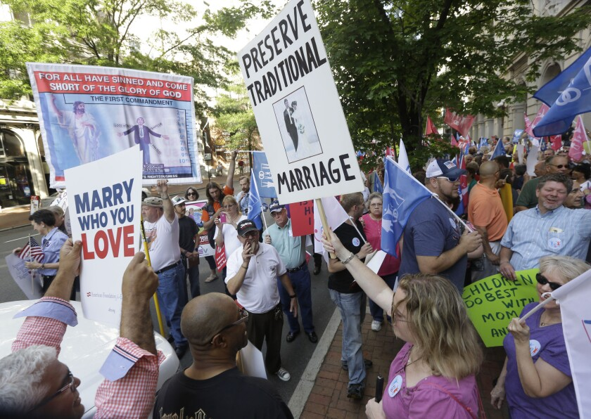 Supporters of traditional marriage and gay marriage demonstrate in Richmond, Va. A federal appeals court refused to block weddings from taking place in the state on Wednesday, meaning couples could begin to wed as early as next week.