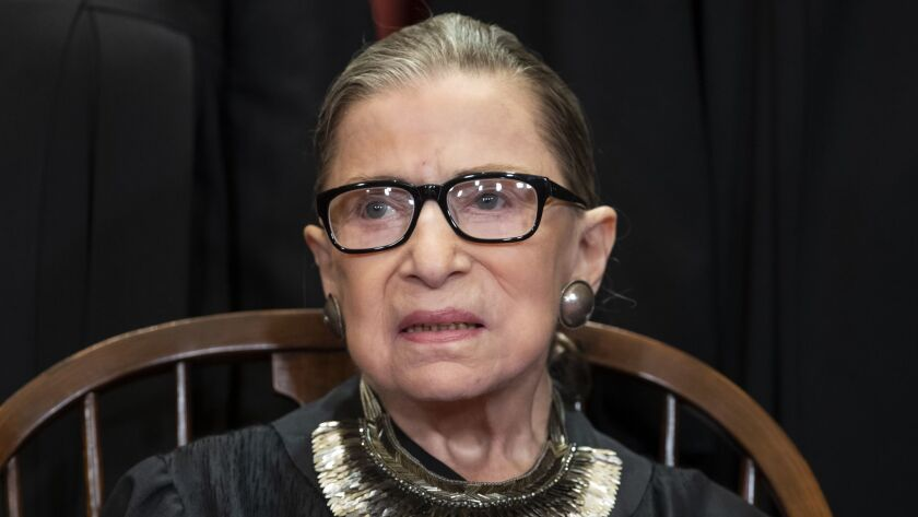 Justice Ruth Bader Ginsburg sits during a formal group portrait at the Supreme Court in Washington on Nov. 30, 2018.
