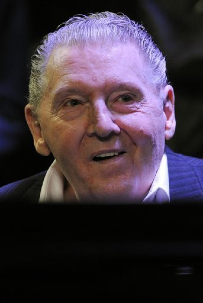 """Jerry Lee Lewis sits behind his piano during """"An Evening with Jerry Lee Lewis"""" at The GRAMMY museum in Los Angeles, Tuesday, Sept. 28, 2010. Lewis turns 75 on Wednesday. (AP Photo/Chris Pizzello)"""