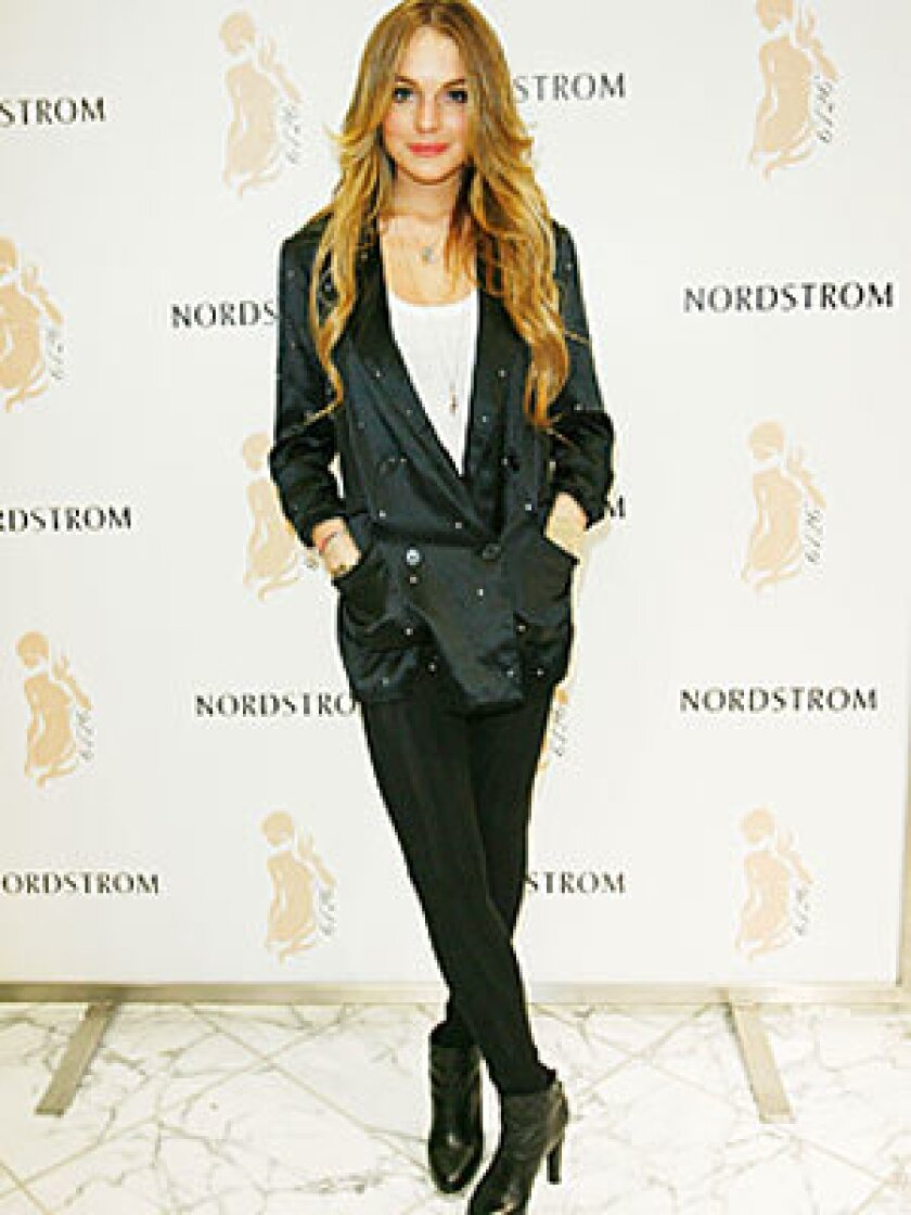 Lindsay Lohan mixes a pair of her own 6126 leggings with a rhinestone-studded tux jacket.