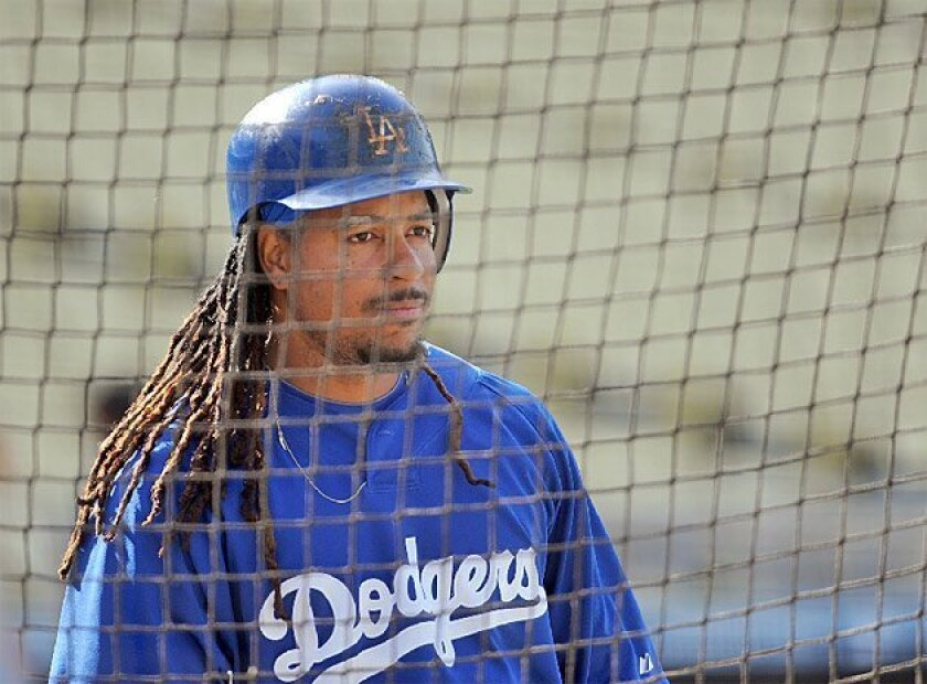Dodgers slugger Manny Ramirez will miss 50 games, but it's not likely to affect the NL West standings. (Getty Images)