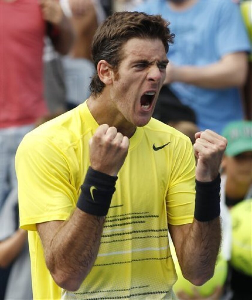 Juan Martin Del Potro of Argentina reacts during his match against Diego Junqueira of Argentina during the U.S. Open tennis tournament in New York, Friday, Sept. 2, 2011. (AP Photo/Paul J. Bereswill)
