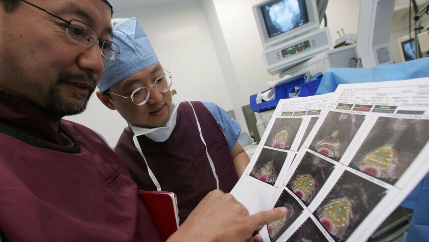 Physicians at UC San Francisco review images of a cancerous prostate before performing a brachythera