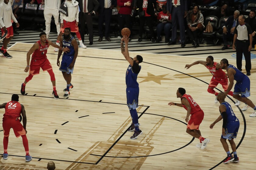 Lakers' Anthony Davis shoots the game-winning free throw during the second half of the NBA All-Star game on Sunday in Chicago.
