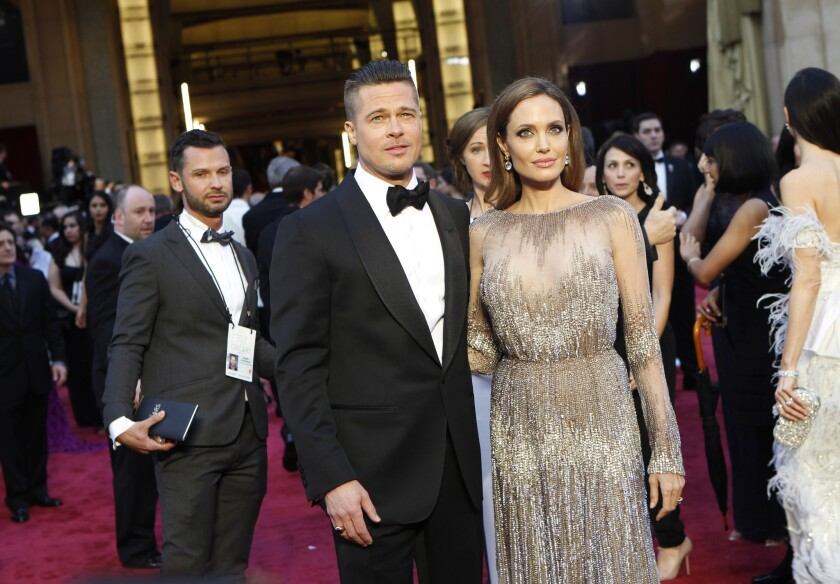 Angelina Jolie, with Brad Pitt at the 86th Academy Awards on Sunday, says she can slip into a softer side at home.