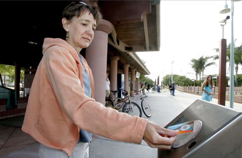 Carolyn Alkire swiped her Compass card at the Carlsbad Village Coaster station.