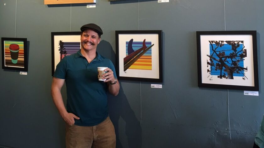 Jon Savage with some of his pop-art on display at Bird Rock Coffee Roasters