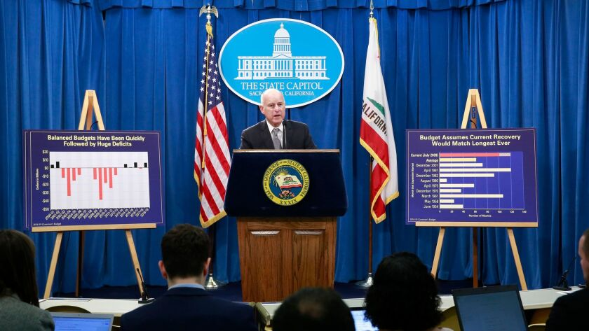 Gov. Jerry Brown discusses his proposed 2018-19 state budget at a news conference Wednesday in Sacramento.