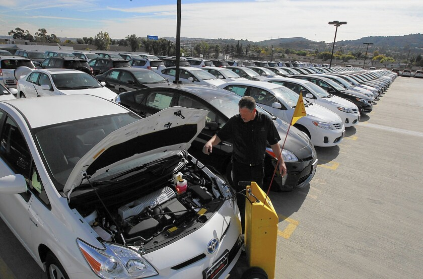 A Prius is recharged at a Puente Hills Toyota dealership. Fuel-efficient cars mean less revenue from gas taxes.