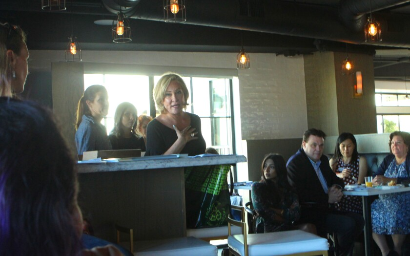 La Jolla Art & Wine Festival founder Sherry Ahern addresses a breakfast meeting of the La Jolla Village Merchants Association, Sept. 17 at Sushi on the Rock.