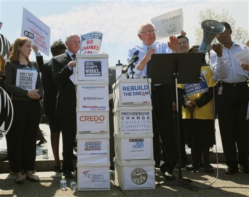 Sen. Bernie Sanders, I-Vt., addresses a group of protesters outside of the White House in Washington, Tuesday, Apr. 9, 2013. Liberal lawmakers from both chambers of Congress and a coalition of like-minded groups rallied outside the White House, voicing frustration at the Democratic president they f