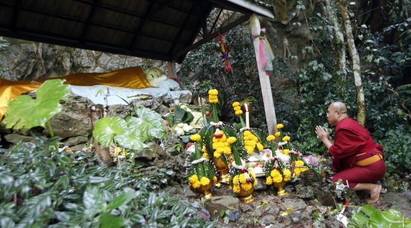 A Thai Buddhist monk pray for 12 boys and their soccer coach, in Mae Sai, Chiang Rai province, north