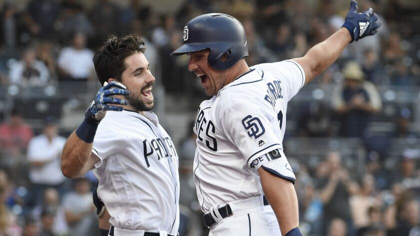 Hunter Renfroe, right, is congratulated by Austin Hedges after hitting a solo home run against the Rockies on September 1.