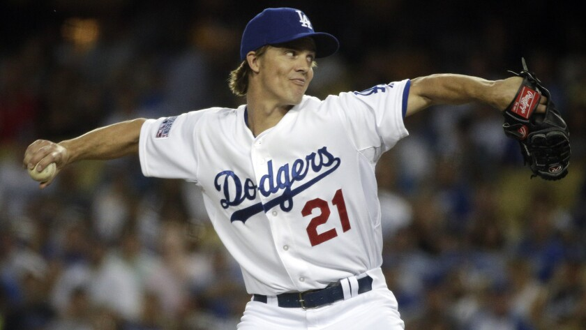 Dodgers starter Zack Greinke delivers a pitch during Game 2 of the National League division series against the St. Louis Cardinals on Oct. 4.