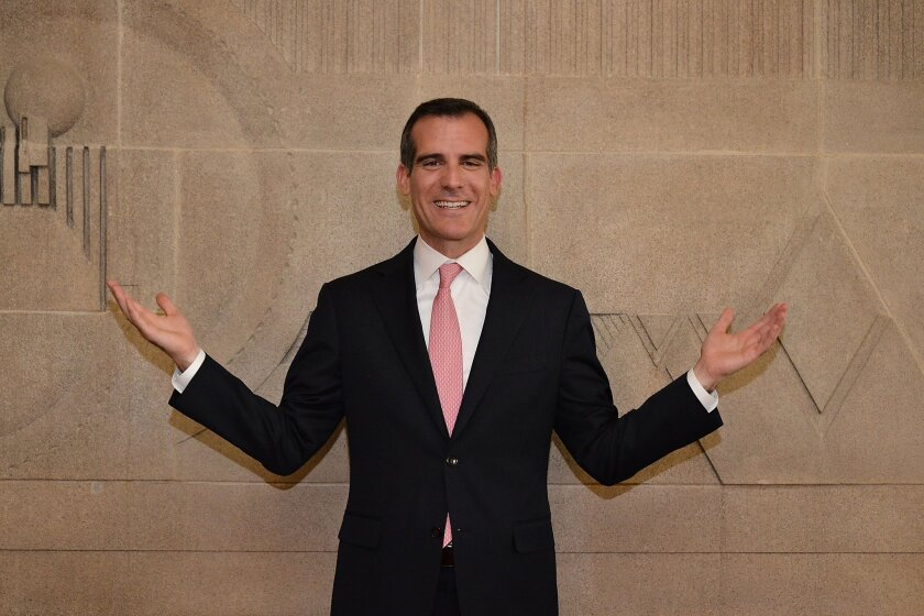 Mayor Eric Garcetti attends the ribbon-cutting ceremony for the re-opening of the Frank Lloyd Wright Hollyhock House on Feb. 13. Despite being a year and a half into his first term, Garcetti still hasn't taken strong positions on many of the region's most divisive issues.