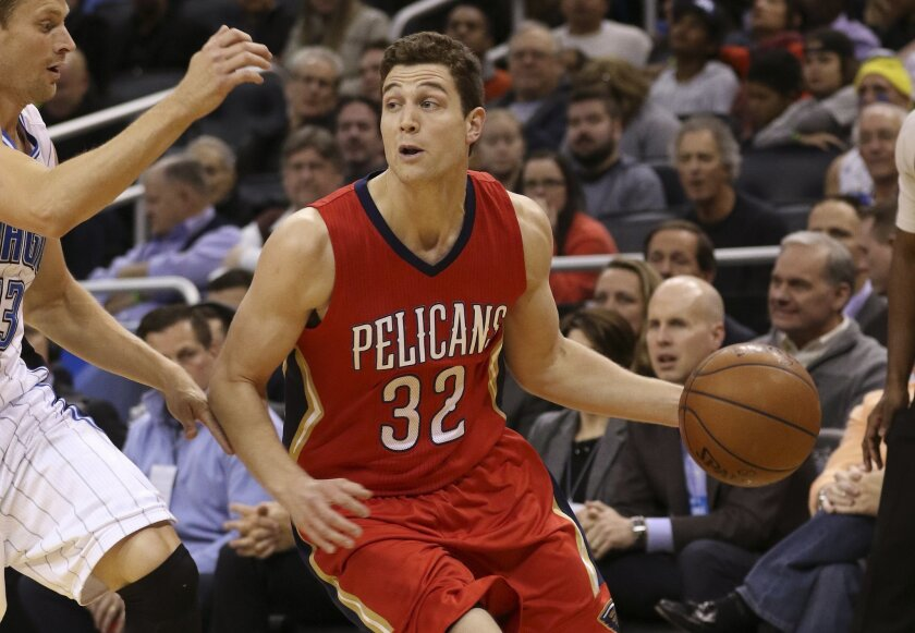 FILE - In this Feb. 20, 2015, file photo, New Orleans Pelicans guard Jimmer Fredette (32) controls the ball during the first half of an NBA basketball game against the Orlando Magic in Orlando, Fla. For Fredette and the NBA D-League All-Stars, hope that the big league will call springs eternal. (AP