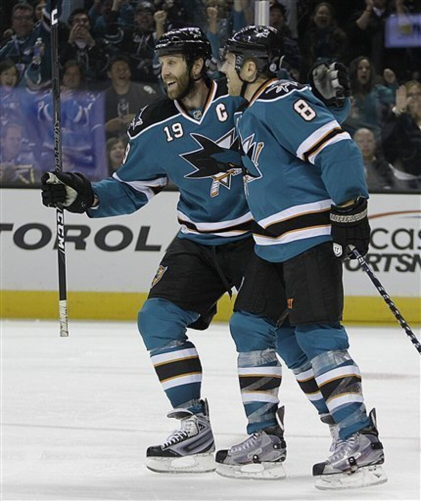 San Jose Sharks' Joe Thornton (19) congratulates Joe Pavelski (8) after Pavelski scored his second goal against the Dallas Stars during the second period of an NHL hockey game Saturday, March 31, 2012, in San Jose, Calif. (AP Photo/Ben Margot)