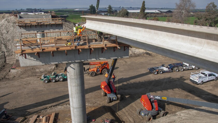 Setting girders at the Kent Avenue overcrossing in Kings County on Construction Package 2-3.