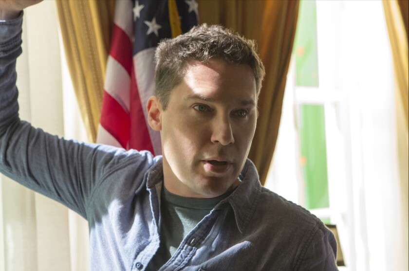 """Director Bryan Singer on the set of """"X-Men: Days of Future Past."""""""
