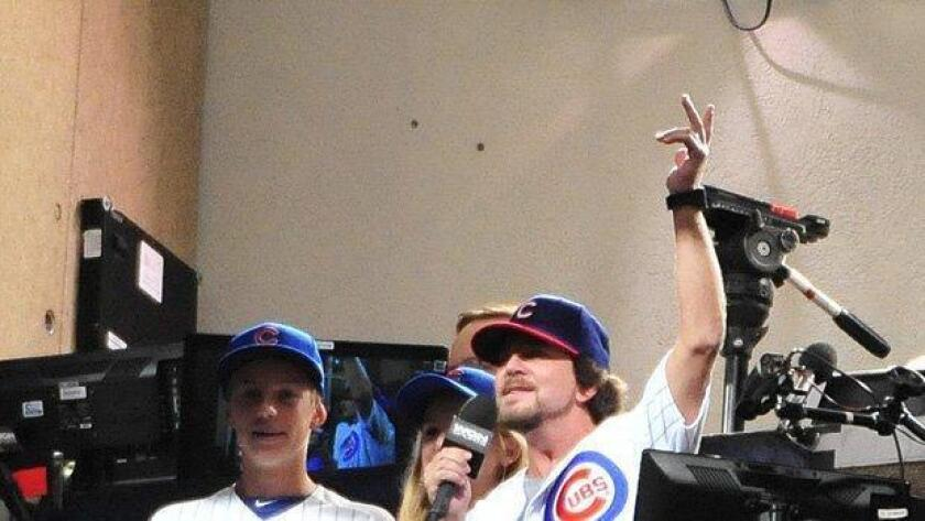 Eddie Vedder Lead Singer of Pearl Jam sings take me out to the ballgame during the seventh inning stretch of a game between the Chicago Cubs and the San Diego Padres on July 24, 2014 at Wrigley Field in Chicago. (/ Getty Images)