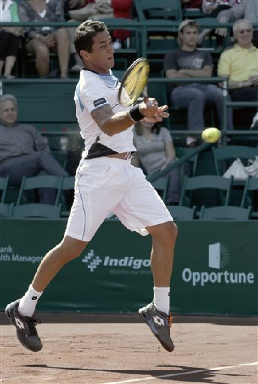 Nicolas Almagro, of Spain, returns a shot to Paolo Lorenzi, of Italy, in their quarterfinal tennis match in the U.S. Men's Clay Court Championship, Friday, April 12, 2013, in Houston. Almagro won 6-4, 6-4. (AP Photo/Pat Sullivan)