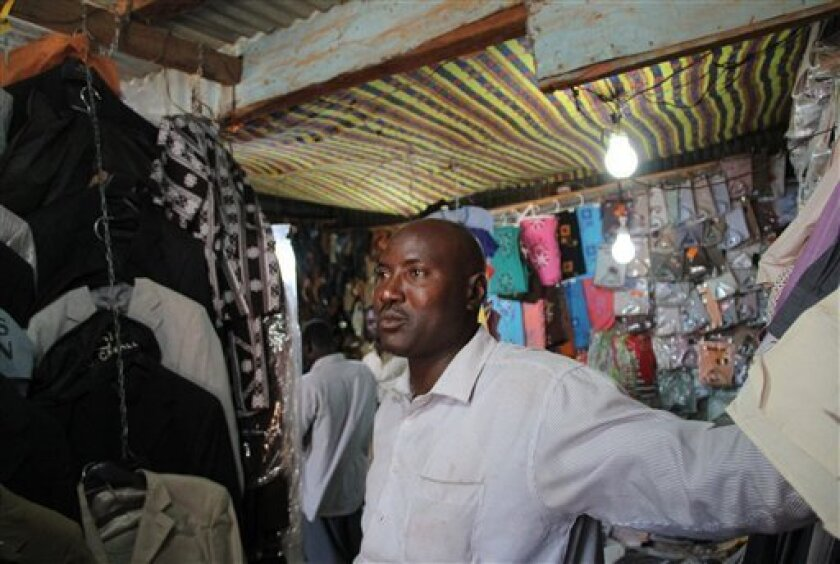 In this photo taken Sunday, Dec. 12, 2010, Ahmed Ibrahm Rahman, stands in his shop in the market in Aweil, Sudan. Rahman has been in Southern Sudan four years, ever since national security agents from the Khartoum government seized hundreds of thousands of dollars of goods from his once-thriving business and threw him in jail in Darfur. The Jan. 9 poll will decide whether Sudan's mainly Christian and animist south can split from its mainly Muslim north. Many Sudanese on both sides of the border are worried the vote could lead to renewed violence or even a return to the two-decade-long north-south civil war ended by a 2005 peace deal. (AP Photo/Maggie Fick)