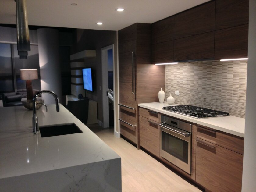 The Pacific Gate model's kitchen, designed by Hirsch Bedner Associates, includes high-end appliances, quartz countertops and cabinets with grain-matched veneer.