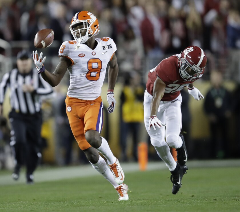 FILE - Clemson's Justyn Ross makes a one-handed catch in front of Alabama's Josh Jobe during the second half of the NCAA college football playoff championship game in Santa Clara, Calif., in this Monday, Jan. 7, 2019, file photo. Ross was selected to The Associated Press Preseason All-America first team offense, Monday Aug. 23, 2021. (AP Photo/Ben Margot, FIle)