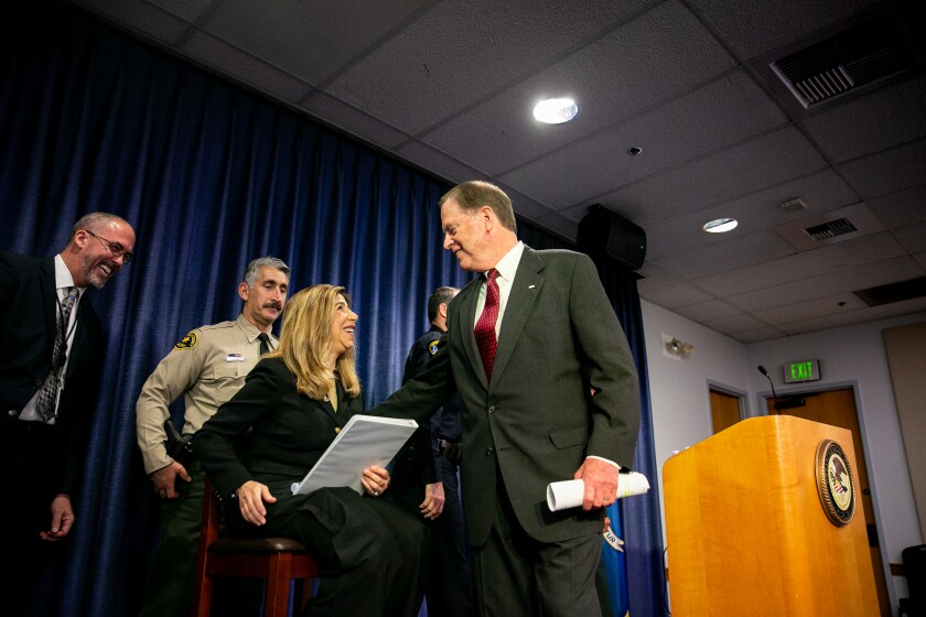 District Attorney Summer Stephan is joined by United States Attorney Robert Brewer as he announces charges against 19-year-old John T. Earnest on May 9, 2019 in San Diego, California. Earnest is currently facing dual federal and state prosecutions.