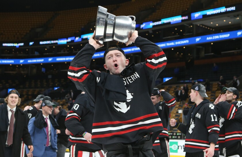 Northeastern's Tyler Madden celebrating after a team's win.