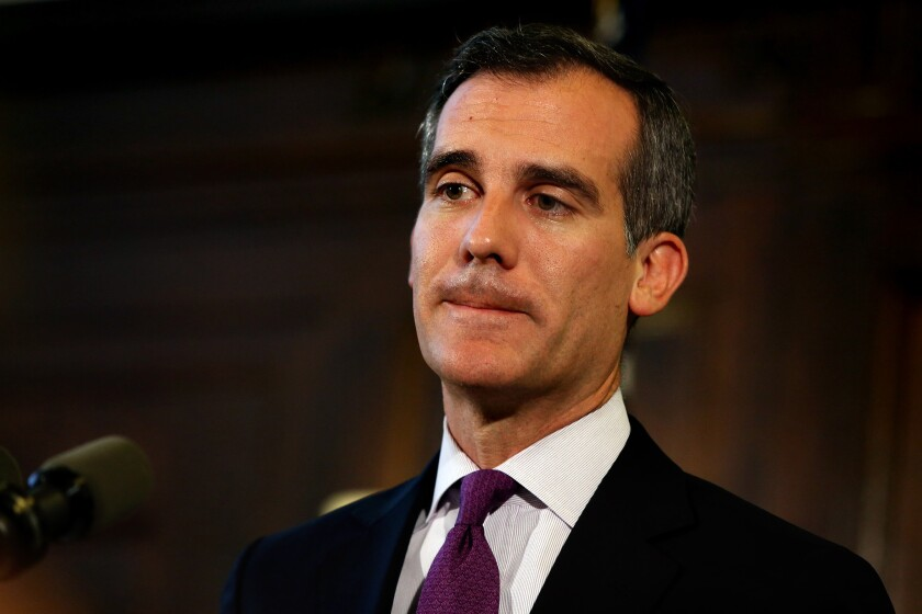 Los Angeles Mayor Eric Garcetti, speaking at City Hall in early June, said Tuesday he would refuse to sign two new ordinances cracking down on homeless people and would block their enforcement until certain provisions are softened.