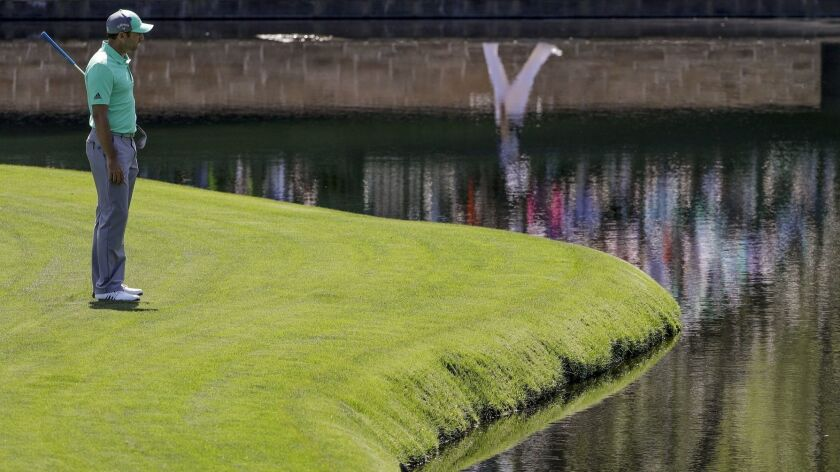 Sergio Garcia, of Spain, looks over the water on the 15th hole during the first round at the Masters