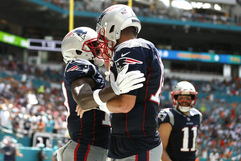 Antonio Brown, left, celebrates with Tom Brady after they connected for a touchdown during Brown's only game with the New England Patriots.
