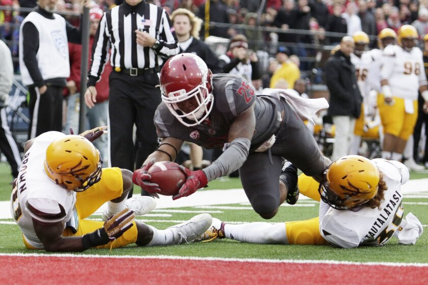 Washington State running back Jamal Morrow (25) dives for a touchdown between Arizona State defensive back Kweishi Brown, left, and defensive back Dasmond Tautalatasi during the second half of an NCAA college football game, Saturday, Nov. 7, 2015, in Pullman, Wash. (AP Photo/Young Kwak)