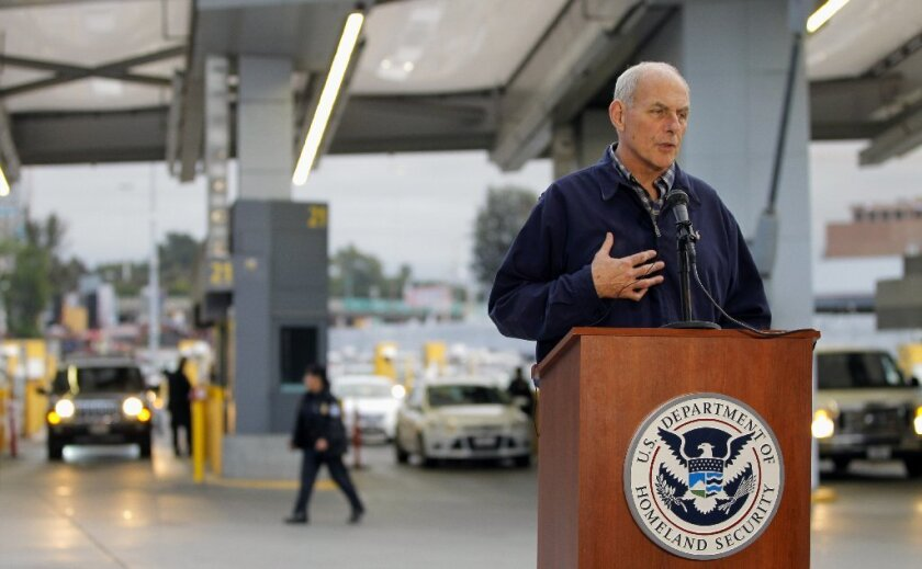 With cars entering the United States from Mexico as his backdrop, Homeland Security Secretary John Kelly spoke about immigration issues at a news conference Friday at the San Ysidro Port of Entry.