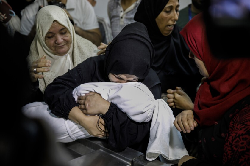 GAZA CITY, GAZA -- MONDAY, MAY 14, 2018: Mariam Mahmud Ahmed Ghandour, mourns her child, Laila Anwar