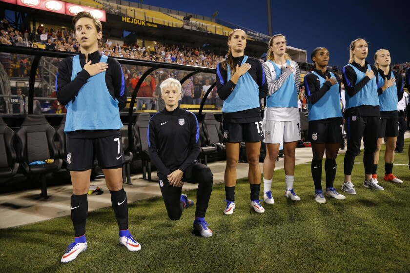 Megan Rapinoe of the U.S. kneels during the playing of the national anthem before the soccer match against Thailand.