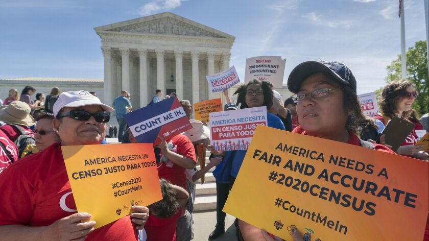 Immigration activists rally outside the Supreme Court in Washington on April 23 during arguments over the Trump administration's plan to ask about citizenship on the 2020 census.