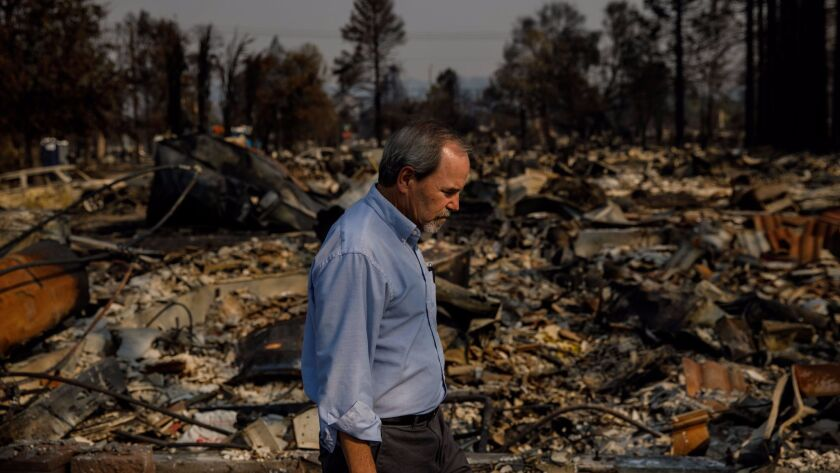 Santa Rosa Mayor Chris Coursey walks through the Coffey Park neighborhood of his city, which was completely leveled by fire at the beginning of the week.