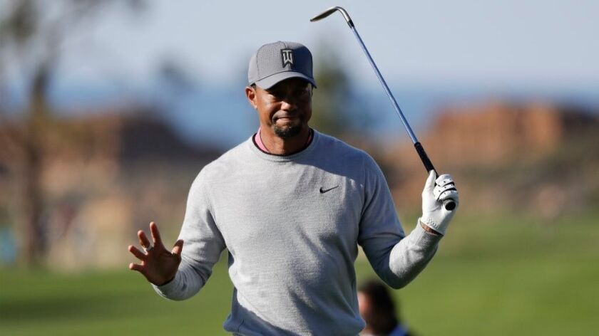Tiger Woods reacts after hitting out of the rough on the ninth hole of the North Course during the second round of the Farmers Insurance Open on Jan. 27.