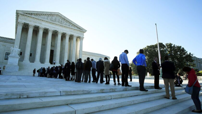 FILE - In this Oct. 3, 2017, file photo, people line up outside the U.S. Supreme Court in Washington