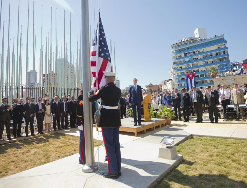 Secretary of State John F. Kerry and other dignitaries watch Friday as U.S. Marines raise the American flag over the newly reopened embassy in Havana.
