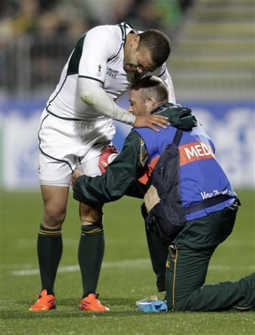 South Africa's Bryan Habana is assisted by a team medic during their Rugby World Cup game against Samoa at North Harbour Stadium in Auckland, New Zealand, Friday, Sept. 30, 2011. (AP Photo/Themba Hadebe).