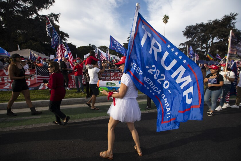 Trump supporters participate in a pre-election rally in Beverly Hills on Oct. 31.
