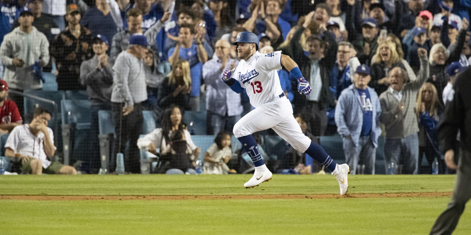 Dodgers second baseman Max Muncy runs after hitting a two-run single to give the Dodgers a 4-0 lead over the Washington Nationals in the seventh inning Thursday.