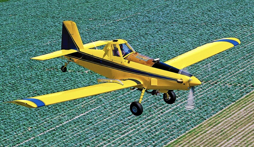 An Air Tractor AT-402B crop-duster flies near the aircraft manufacturer's Olney, Texas, facility. Exports account for about 50% of the company's revenue, and the Export-Import Bank insures about half of those transactions.
